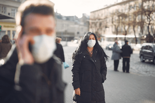 how coronavirus spreads people wearing masks